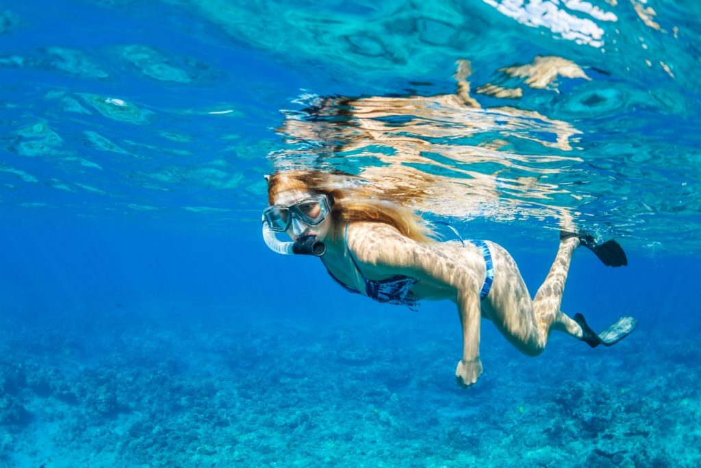 Woman Snorkeling in Tropical Ocean